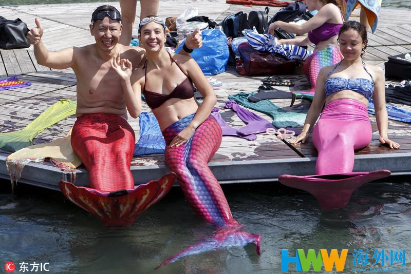 瑞士民众扮美人鱼在日内瓦湖游泳