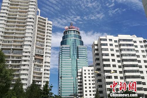 资料图:北京市亚运村北辰附近某小区楼外景。<a target=&#39;_blank&#39; href=&#39;http://www.chinanews.com/&#39; >中新网</a> 程春雨 摄