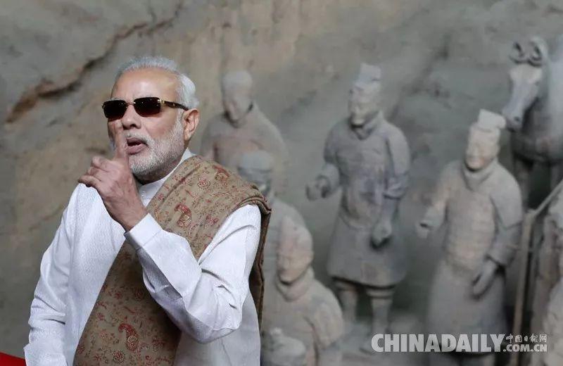 ▲资料图片:2018-07-23,正在中国进行正式访问的印度总理莫迪来到陕西西安市秦始皇帝陵博物院参观兵马俑。( 《中国日报》)