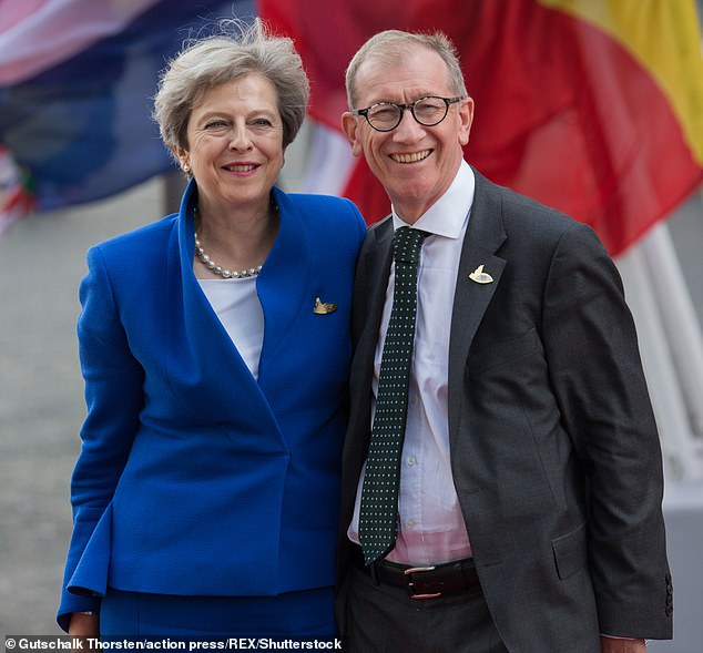 6293242-6399409-Mrs_May_pictured_with_her_husband_Philip_in_Hamburg_says_she_wil-a-2_1542438766861.jpg