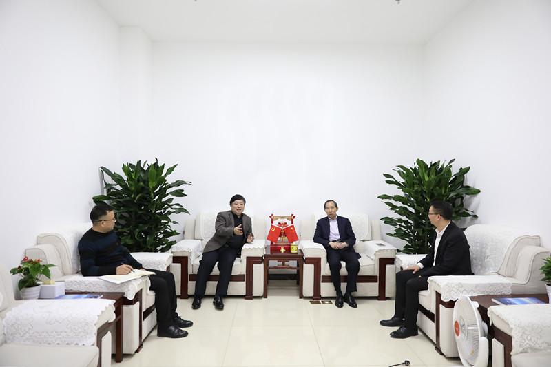 龙宇翔与湖南省委网信办主任周湘座谈交流