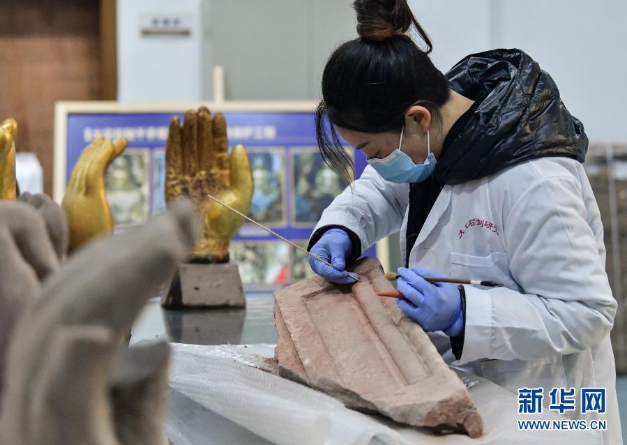大足石刻:加强保护研究 活化文物利用