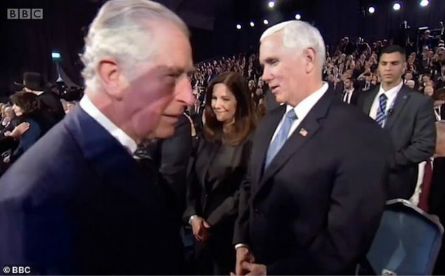23782262-7921449-Prince_Charles_appeared_to_snub_Vice_President_Mike_Pence_at_an_-m-44_1579798151722_meitu_4.jpg