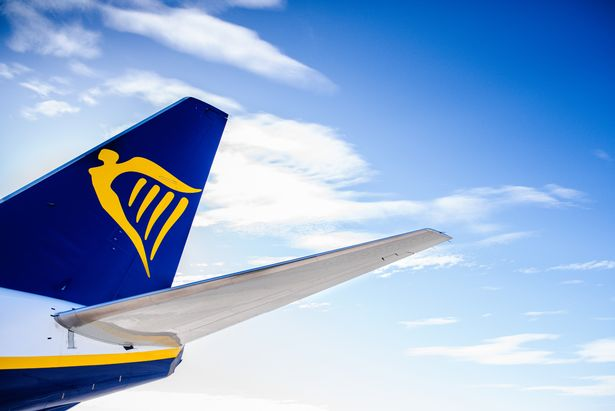0_Tail-of-a-plane-of-the-Ryanair-travel-company-isolated-with-blue-cloud-background.jpg
