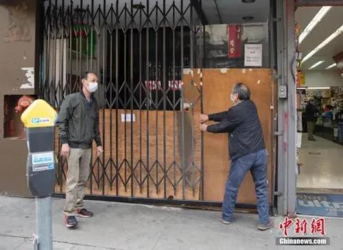 资料图:当地时间5月18日,美国旧金山华埠一家店铺重新营业后,又在中午时分关上了大门。<a target='_blank' href='http://www.chinanews.com/'>中新社</a>记者 刘关关 摄