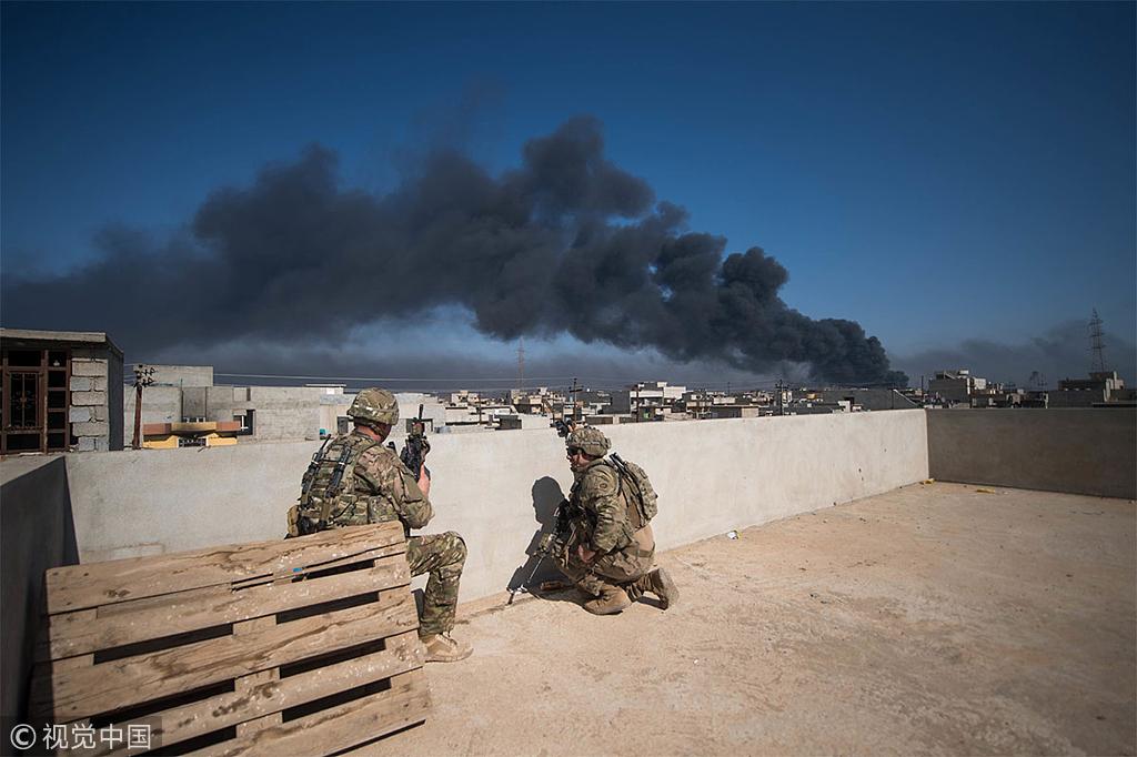 资料图:在伊拉克执行任务的美国军人