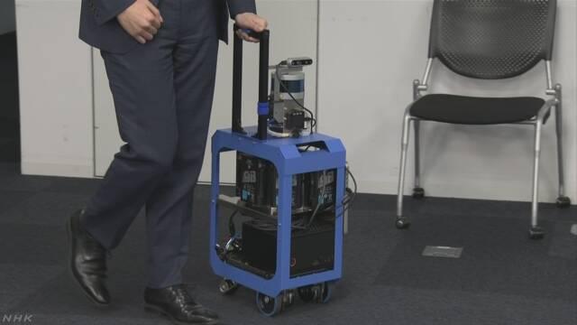 盲人福音!日本研发AI手提箱 可导航可认亲属