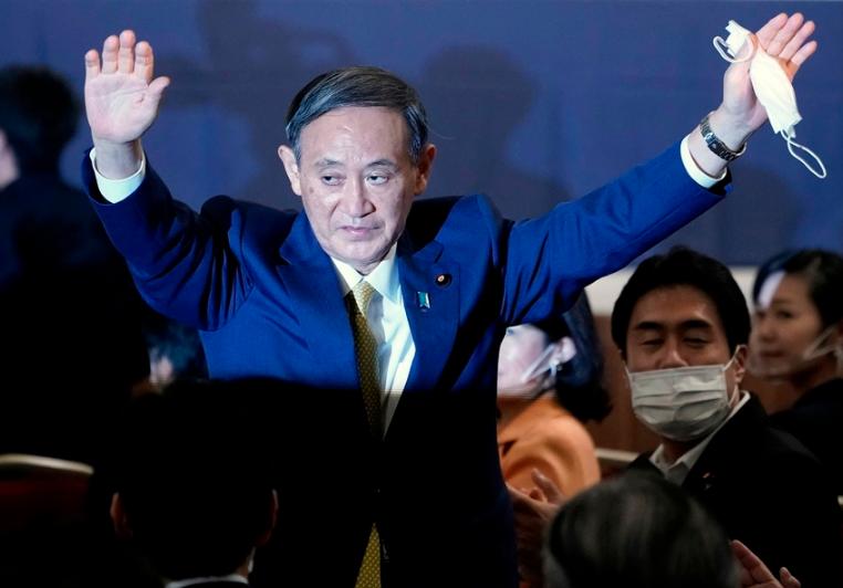 菅义伟胜选后火速办完两件大事 首次坐总裁位罕见露笑容