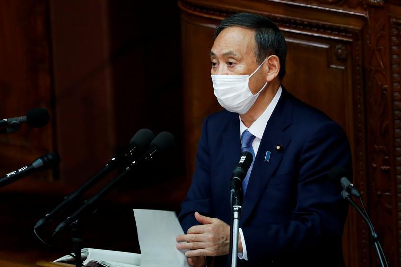 菅义伟参加就任后的首场国会答辩(路透社)